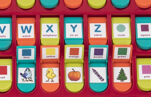 Close up photo of alphabet toy with letters, colors, and illustrations.