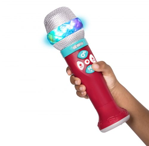 Hand holding toy microphone.