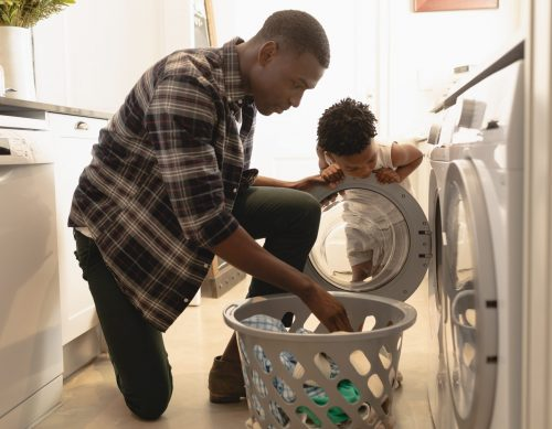 Father and son doing laundry.